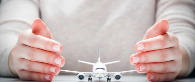 travel-insurance-hands-plane.jpg