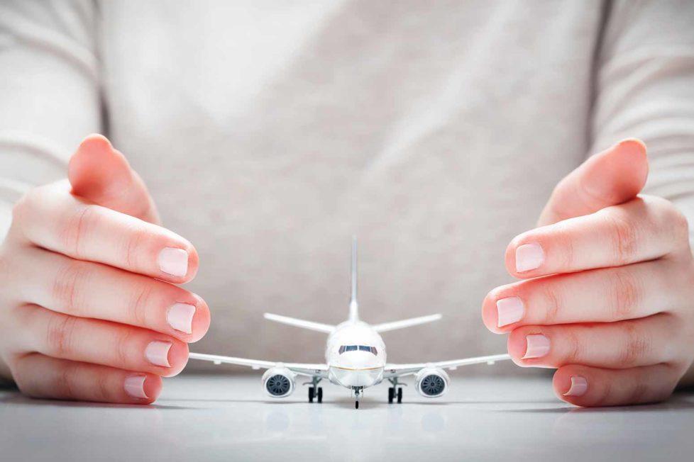 travel-insurance-hands-plane.jpg